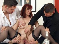 Mature redhead loves two big dicks