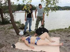 Mature beach babe enjoys two men