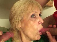 Granny can suck on two cocks