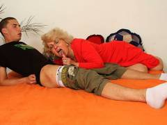 Young man thrusting into granny