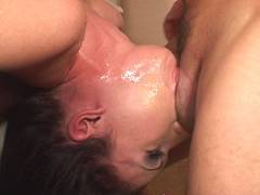 Brunette slurping cocks
