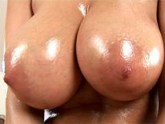 Oiled pussy is rubbed